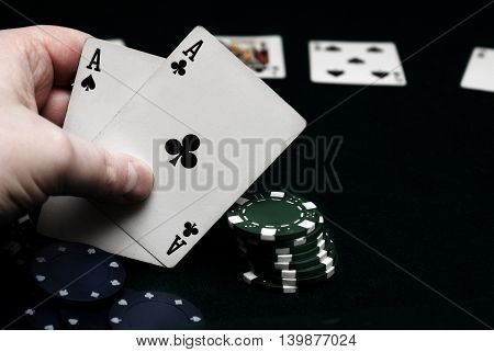 A hand of pocket aces in texas holdem.