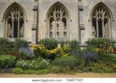 A beautiful close-up view of the architecture and flowers at St. John's College in Cambridge UK.