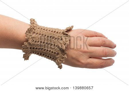 Knitted handmade brown bracelet isolated on white background