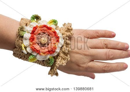 Brown hand- Knitted bracelet isolated on womans hand