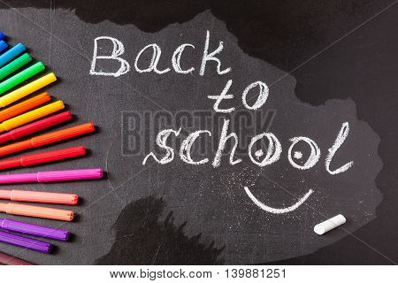 Back to school background with colorful felt tip pens and title