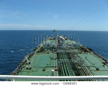 Large oil tanker approaching FPSO