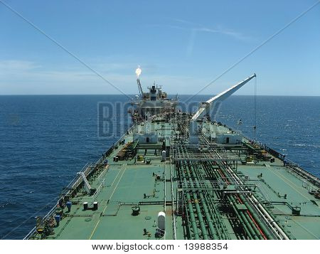 Large oil tanker loading from FPSO