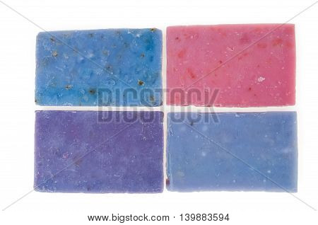 Molticolor soaps handmade with organic oil of lavender ond another flowers, isolated on white