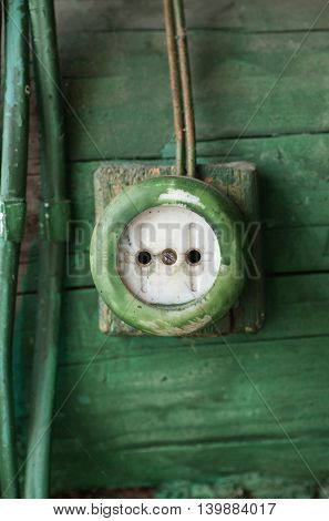 Old Electric Outlet On Wooden Wall