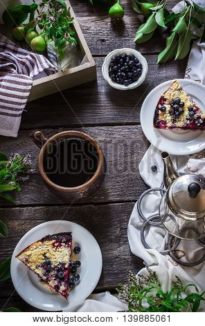 Cup Of Tea And Slice Of Blueberry Pie On Dark Wooden Background.