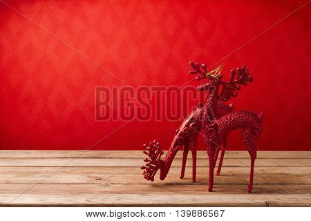 Christmas holiday background with wooden table and deer ornament