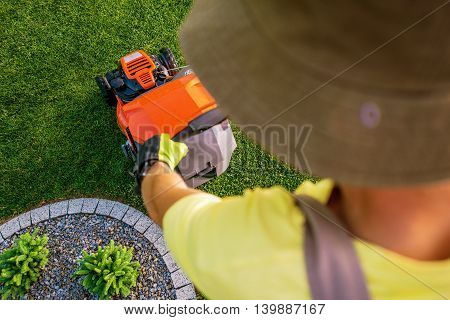 Gardener Mowing Grass Using Professional Gasoline Lawn Mower. Top View.