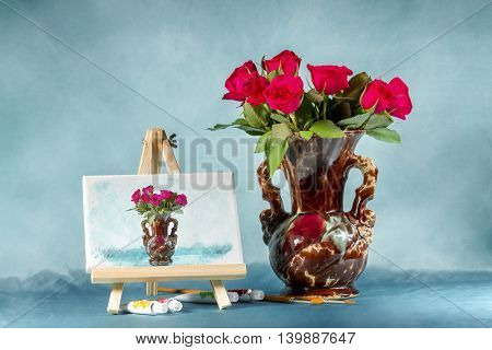 Collage with a bouquet of roses, easel and watercolors. Digital picture on an easel stylized watercolor.