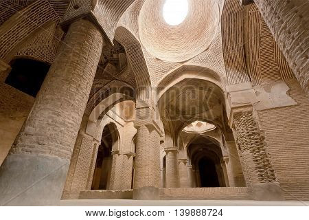 Daylight from ceiling of historical Jameh Mosque of Isfahan, Iran. Isfahan is example of Islamic culture