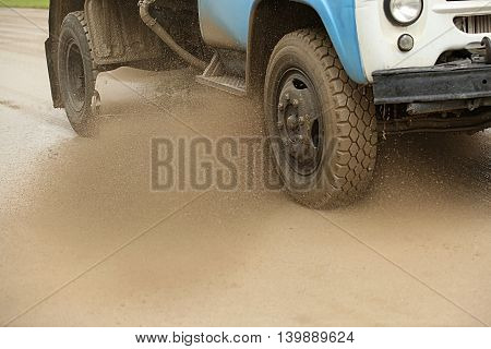 Sweeper Cleans Dirt Road