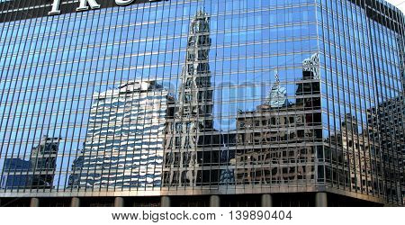 Reflections of buildings on a building in chicago