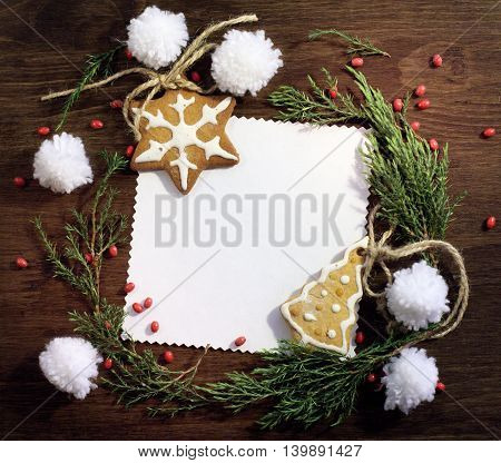 flat lay congratulatory background with figured ginger cookies and decorations / happy Christmas backgrounds
