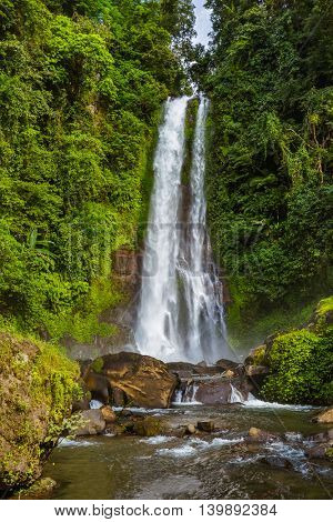 Gitgit Waterfall on Bali island Indonesia - travel and nature background