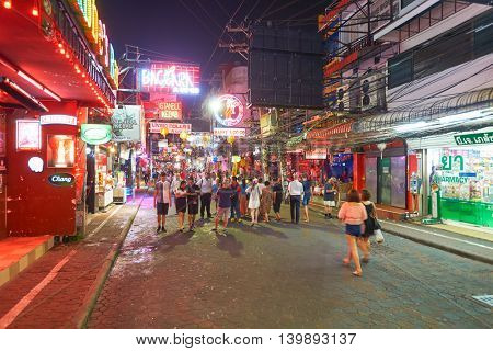 PATTAYA, THAILAND - CIRCA FEBRUARY, 2016: Walking Street in Pattaya at night time. is a red-light district in the city of Pattaya, Thailand