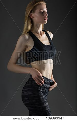 Beautiful sexy blonde woman perfect athletic slim figure engaged in yoga exercise or fitness lead healthy lifestyle eats right dressed in comfortable casual clothes sport pilates diet