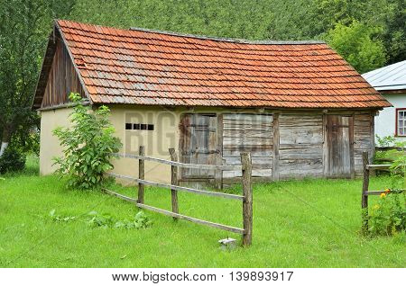 Ancient traditional ukrainian rural wooden barn, Kiev