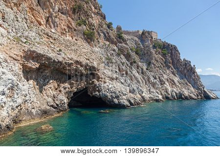 Marine walk near the rocks of Turkey, The grotto in the rock above the water