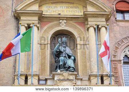 BOLOGNA , ITALY - DECEMBER 28, 2015 : Pope Gregory XIII statue on King Enzo palace at Bologna main square