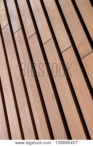 Diagonal pattern in wood wall, light and dark stripes