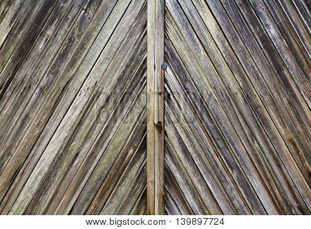 Close up of diagonal rustic wooden planks in a door