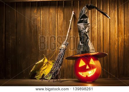 Jack o lanterns Halloween pumpkin face on wooden background and spooky