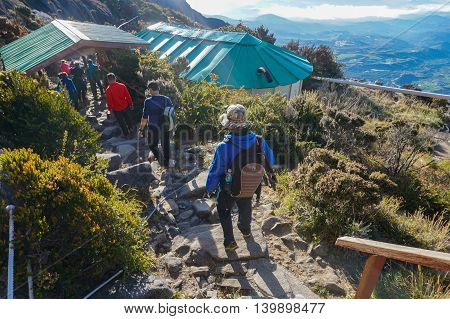 Ranau,Sabah,Borneo-March 13,2016:Group of climbers arrived from Low's Peak to Sayat Sayat check point after successfully completed conquering the mountain Kinabalu at Sabah Land Below The Wind.