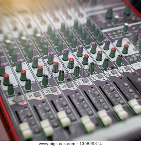 audio mixer music equipment. recording studio gears broadcasting tools mixer synthesizer. shallow dept of field for music background