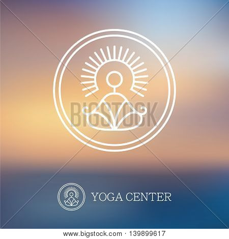 Round outline yoga logo with abstract symbol of man in meditation pose on blurred background
