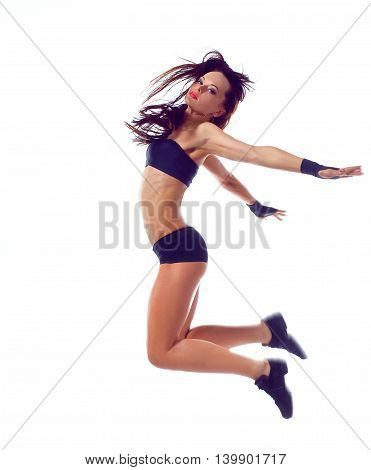 Stylish and young modern style dancer jumping.