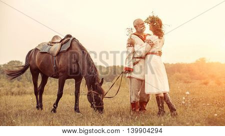 Dating Of Mature Man And Woman On The Rural Summer Background.