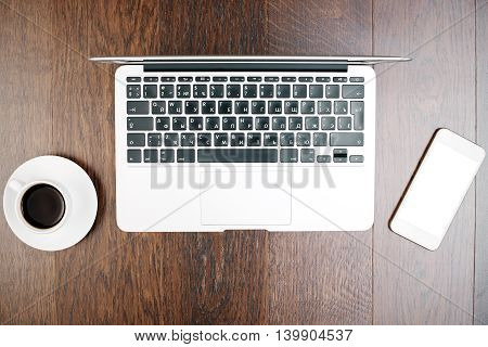 Coffee, White Cellphone And Laptop