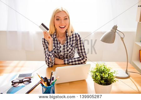 Excited Woman With Bank Card Having An Idea What To Buy