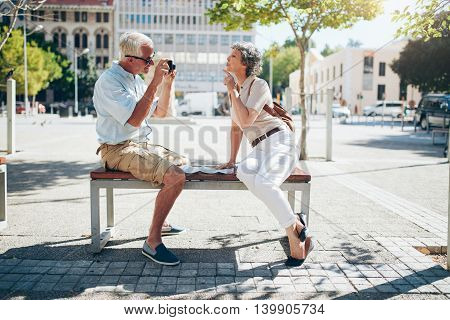 Senior Couple Taking Pictures Of Each Other