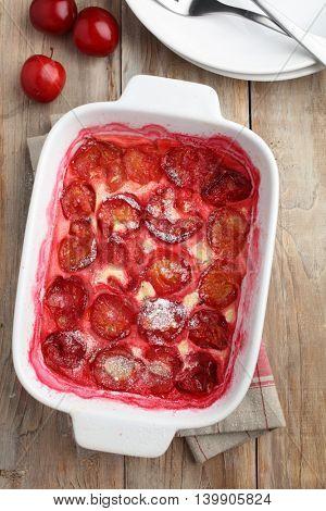 Plum clafoutis in a baking dish
