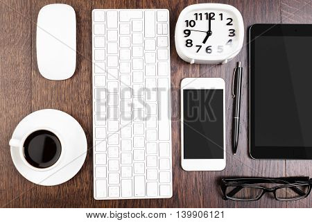 Electronic Devices On Wooden Desk