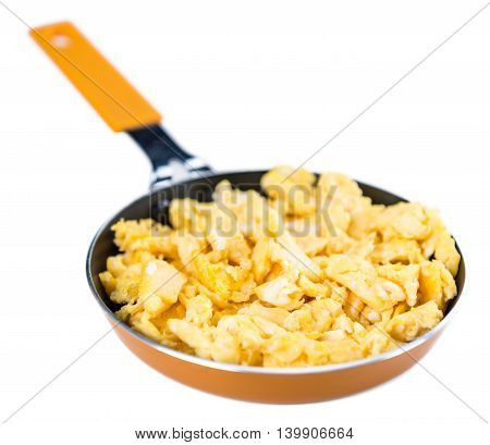 Scrambled Eggs In A Pan Isoalted On White