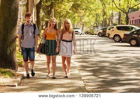 Three People Friends Walking Outdoor.