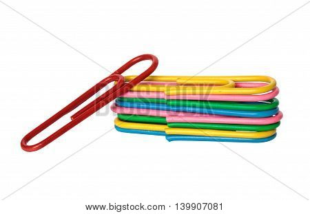 colored paper clips on a white background pile