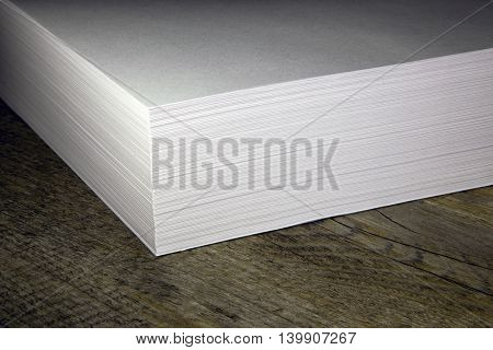 a stack of white paper for the printer