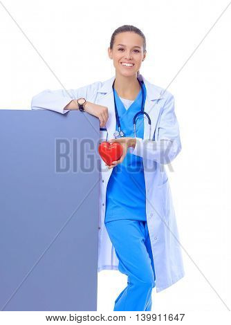 Closeup portrait doctor with stethoscope, holding heart, blank white paper