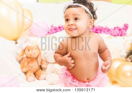 Cute Baby Girl With Pillows and Balloons
