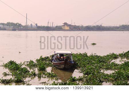 boat in saigon river ho chi minh city vietnam