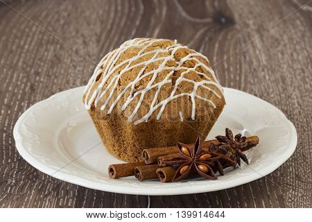 sweet muffin in a white plate on the wooden table
