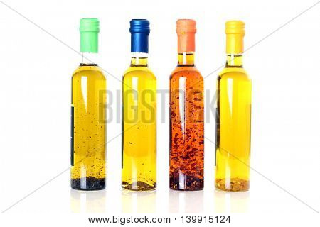 Bottles of extra virgin olive oil infused with mediterranean herbs.