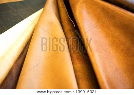 Natural cow leathers in different colors. Sample leathers.