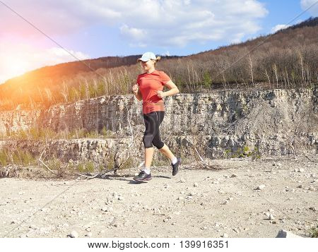 Young Woman Running In Nature.