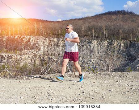 Fat Man Running In Nature.
