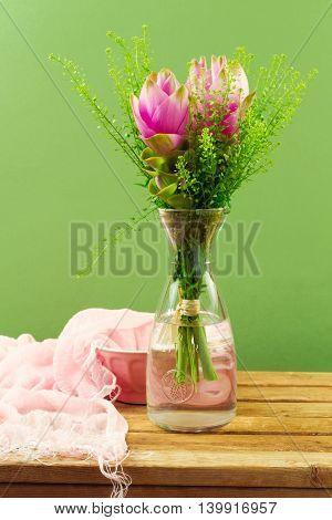 Beautiful pink flower bouquet over green background