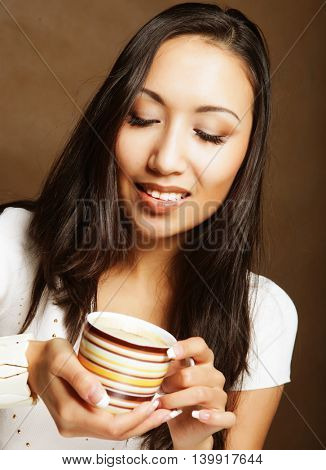pretty asian woman drinking coffee